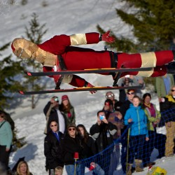 """Iron Man"" flies above the crowd at the 2012 Dummy Downhill on the Mission Ridge Ski area."